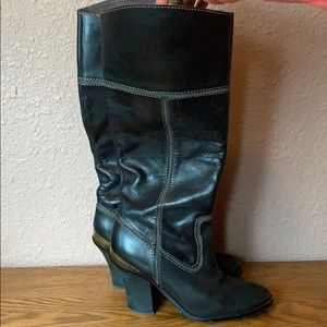 Black leather cowboy style boots